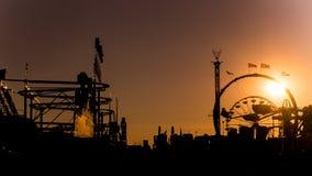 Окружная ярмарка на заходе солнца Стоковые Изображения