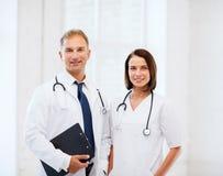 2 доктора с стетоскопами Стоковые Изображения RF