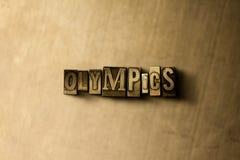 ОЛИМПИАДЫ - конец-вверх grungy слова typeset годом сбора винограда на фоне металла стоковые изображения