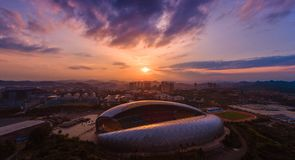 Олимпийский спортивный центр на заходе солнца стоковое фото rf
