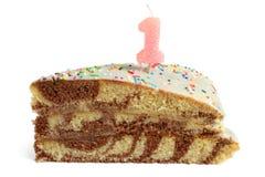 ломтик одно свечки именниного пирога Стоковые Фото
