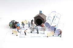 дом здания на светокопиях с конструкцией работника Стоковые Изображения RF
