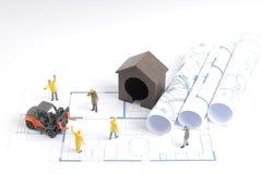 дом здания на светокопиях с конструкцией работника Стоковые Фото
