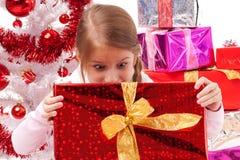 Она удивлена от подарка Стоковая Фотография RF