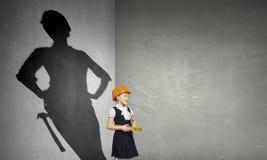 Она хочет стать архитектором Мультимедиа стоковая фотография rf