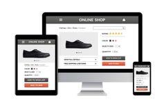 Онлайн концепция магазина на электронных устройствах изолированных на белой задней части стоковые фото