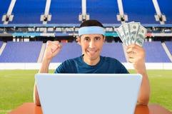 Онлайн держать пари в долларе Стоковое фото RF