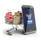 Он-лайн принципиальная схема покупкы Мобильный телефон или smartphone с тележкой Стоковое фото RF