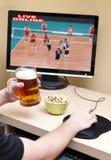 он-лайн наблюдать спорта стоковое фото rf