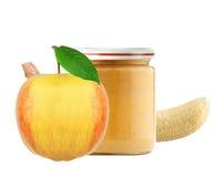 Опарник пюра, яблока и банана младенца изолированных на белизне Стоковые Фото