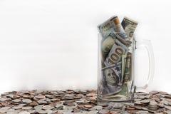 Опарник с деньгами над монетками Стоковое Изображение