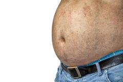 Опасности сала живота , Брюзгливый человек в джинсах сжимает живот стоковые фотографии rf