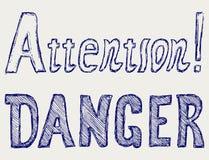 Опасность и внимание слова Стоковая Фотография RF