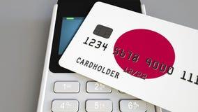 Оплата или стержень POS при кредитная карточка отличая флагом Японии Японские розничные коммерция или банковская система схематич стоковые фото