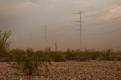 Опоры линии электропередач в пустыне Стоковые Фото