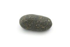 Определите простой черный естественный камень изолированный на белой предпосылке стоковые фото