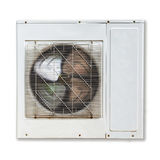 Опрокинутый компрессор воздуха белого металла налево изолированным Стоковая Фотография