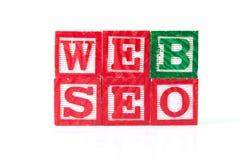 Оптимизирование поисковой системы сети SEO - блоки младенца алфавита на whi Стоковое Изображение RF