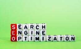 Оптимизирование поисковой системы SEO на зеленом цвете Стоковые Изображения