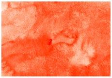 Оранжевая абстрактная текстура краски акварели на холсте, предпосылке бумаги стоковая фотография
