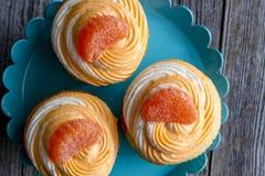 Оранжевая ванильная фасоль завихрялась пирожные Стоковое Фото