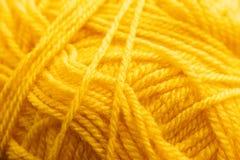 Оранжевая вязать текстура потока, фон дела рук Стоковое фото RF