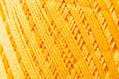 Оранжевая вязать текстура потока, фон дела рук Стоковые Фотографии RF