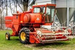 Оранжевая жатка зернокомбайна Стоковые Изображения RF