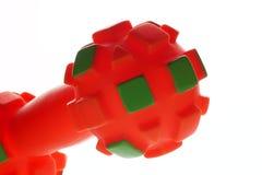 Оранжевая игрушка игры собаки Стоковое фото RF