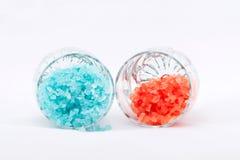 Оранжевая и голубая соль для принятия ванны Стоковое Фото