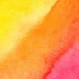 Оранжевая и желтая предпосылка акварели Стоковая Фотография
