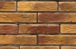 Оранжевая и коричневая текстура кирпичной стены Стоковое Изображение RF