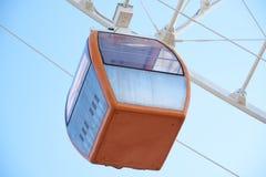 Оранжевая кабина колеса ferris стоковая фотография rf