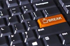 Оранжевая кнопка с словом и кофе пролома Стоковые Фото