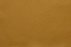 Оранжевая кожаная grained картина предпосылки текстуры Стоковая Фотография