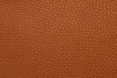 Оранжевая кожаная grained картина предпосылки текстуры Стоковые Изображения RF