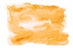 Оранжевая краска руки искусства предпосылки акварели на текстуре бумаги стоковые фото