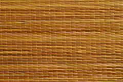 Оранжевая поверхность циновки соломы цвета Стоковое Изображение RF