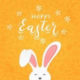 Оранжевая предпосылка с картиной и текст счастливая пасха с кроликом Стоковое Фото