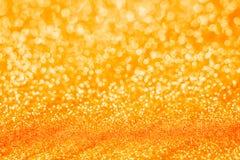 Оранжевая предпосылка конспекта bokeh нерезкости Нового Года Стоковая Фотография