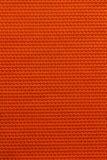 Оранжевая предпосылка текстуры ткани Стоковое Изображение