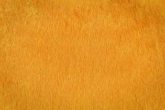 Оранжевая текстура искусственного меха Стоковые Изображения