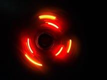 Оранжевая фиолетовая волна круга в темной предпосылке Стоковая Фотография RF