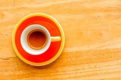 Оранжевая чашка кофе эспрессо Стоковая Фотография