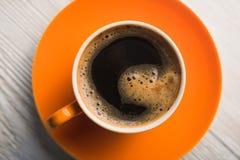 Оранжевая чашка кофе Стоковое фото RF