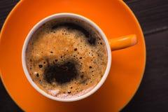 Оранжевая чашка кофе Стоковая Фотография RF