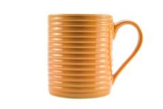 Оранжевая чашка Стоковые Фото