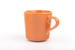 1 оранжевая чашка Стоковое фото RF