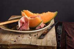 Оранжевая дыня с ветчиной Стоковая Фотография