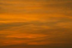 Оранжевое и серое небо в evenning Стоковое Изображение RF